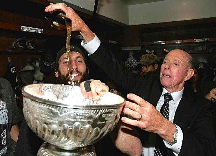 NHL hockey kings trainer Peter Demers and team drinks from  Stanley cup with victory